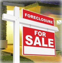 Picture of a for sale sign in front of a bank owned foreclosure