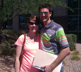 Picture of husband and wife in front of title company after signing loan documents to buy their home and who recommend Kristina and Ron Wilczek as Mesa Realtors