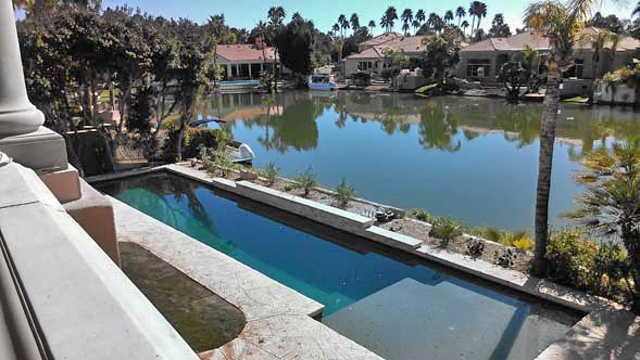 image of Phoenix real estate investment with backyard swimming pool that sits on a lakefront lot