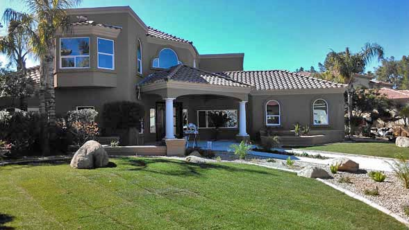 image of the front view of a luxury home that became a Metro Phoenix real estate investment