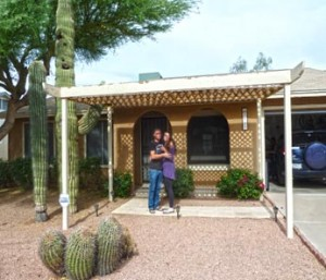 Phoenix realtors are recommended by homebuyers standing in front of their new home